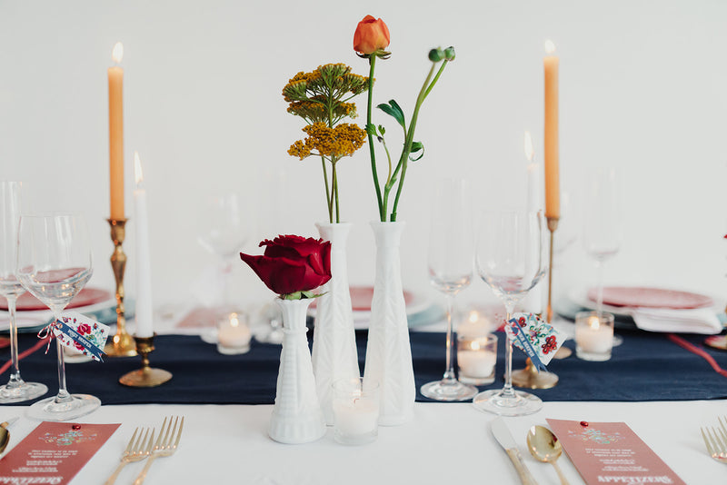 Milk glass vases with bright florals as centerpieces