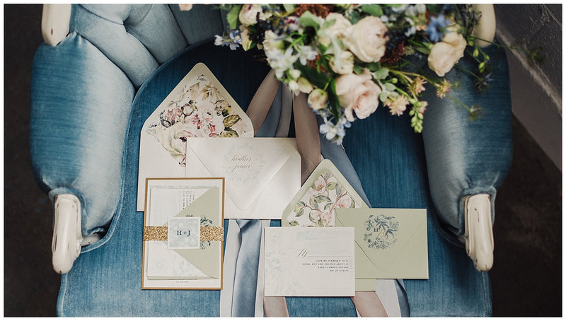 Wedding invitation suite on blue velvet chair