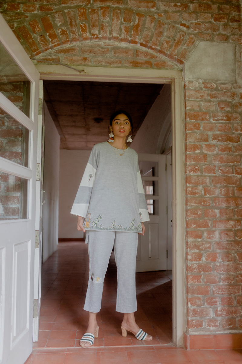 Sui | THE CORNER embroidered long top crafted in hemp with organic cotton detailing from Flow Winter Collection 2019