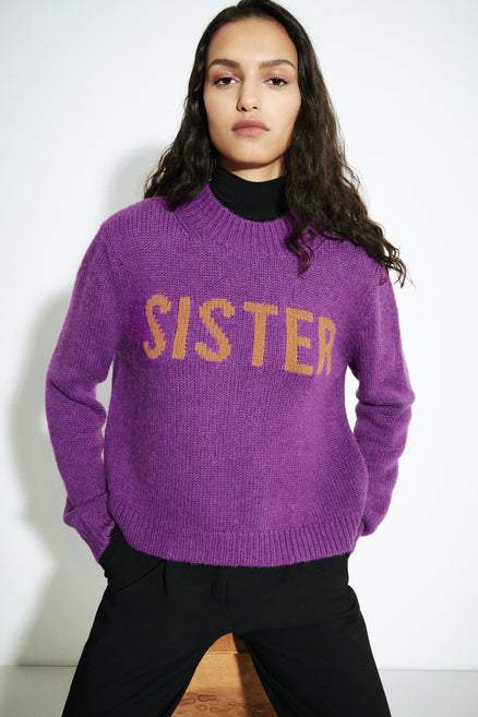 model shot of purple-sister-alpaca-wool-sweater with a flattering mock turtleneck From Chinti & Parker