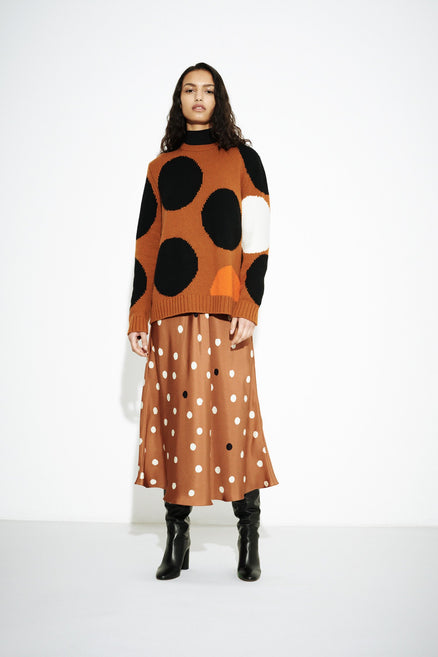 model shot of ginger-dot-wool-cashmere-sweater oversized polka dot intarsia in a slouchy-fit From Chinti & Parker