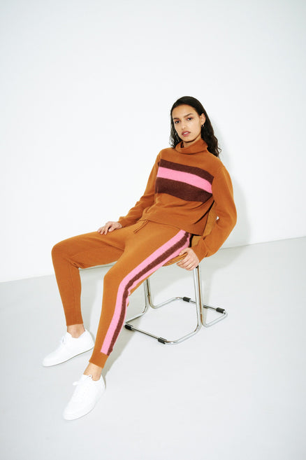 model shot of ginger-alpaca-striped-merino-cashmere-turtleneck fluffy stripe, funnel neck and cropped From Chinti & Parker