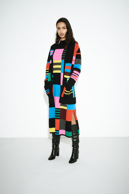 model shot of multicolour-eccentric-wool-cashmere-sweater-dress with geometric intarsia and turtleneck From Chinti & Parker