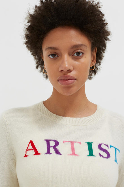 model shot of soft cream-artist-wool-cashmere-sweater with multicoloured intarsia and boxy fit From Chinti & Parker
