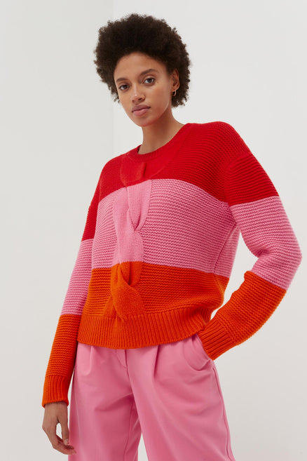 model shot of red-giant-cable-wool-cashmere-sweater chunky with oversized cable detail in a boxy fit From Chinti & Parker