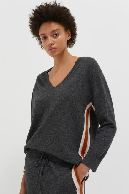 model shot of soft grey-heritage-striped-wool-cashmere-sweater relaxed fit V-neck with a sporty finish. From Chinti & Parker
