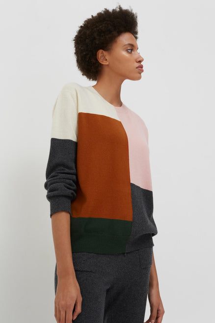 model shot of pink-colour-block-wool-cashmere-sweater with colour-block lightweight intarsia From Chinti & Parker