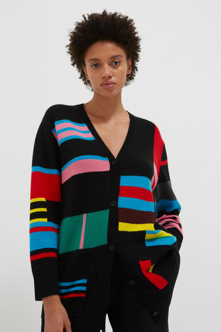 model shot of multicolour-eccentric-wool-cashmere-cardigan longline with a geometric intarsia pattern From Chinti & Parker