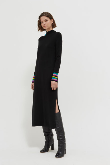 model shot of black-bloomsbury-wool-cashmere-turtleneck-sweater-dress with colourful striped cuffs From Chinti & Parker