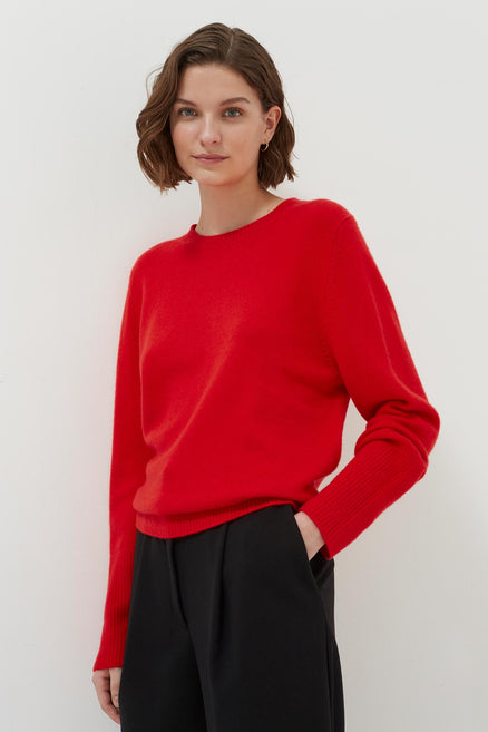 model shot of red-cashmere-boxy-sweater-1 heavier knit with a loose silhouette with ribbed cuffs From Chinti & Parker