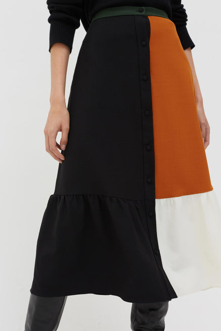 model shot of black-colour-block-wool-twill-skirt with a touch of stretch, a structured, feminine shape From Chinti & Parker