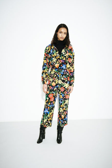 model shot of black-charleston-floral-print-silk-blouse with gathered shoulders and buttoned cuffs From Chinti & Parker