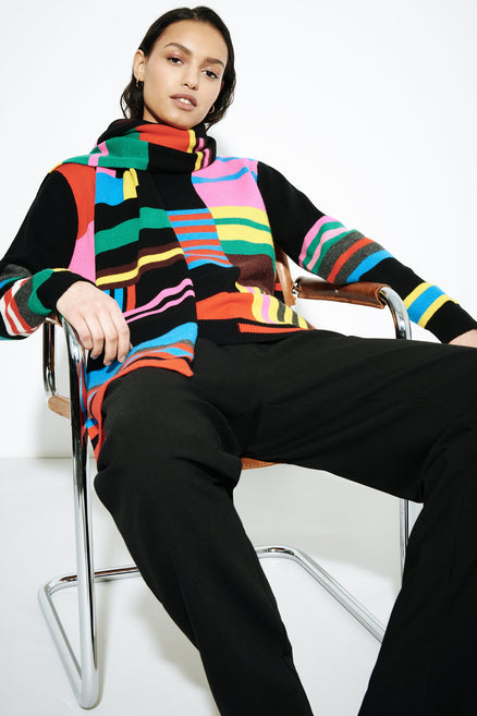 model shot of multicolour-eccentric-wool-cashmere-sweater With bold stripes and geometric shapes From Chinti & Parker