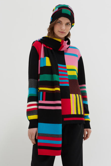 model shot of black-eccentric-wool-cashmere-scarf extra long with abstract intarsia , a pop of colour From Chinti & Parker