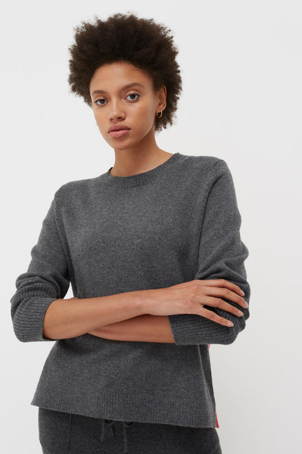 model shot of grey-ribbed-back-cashmere-sweater-2 in boxy-fit with a red ribbed panel From Chinti & Parker