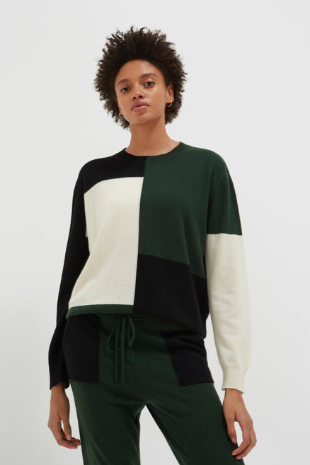 model shot of black-colour-block-wool-cashmere-sweater with colour-block lightweight intarsia From Chinti & Parker