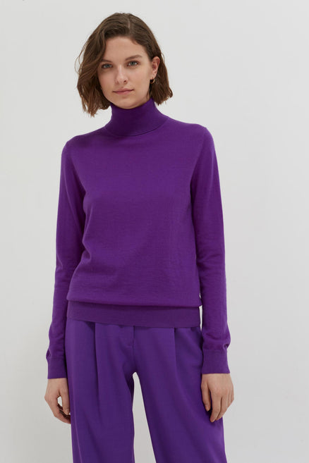 model shot of purple-rollneck-cashmere-pop-sweater Is slim-fitting and lightweight From Chinti & Parker