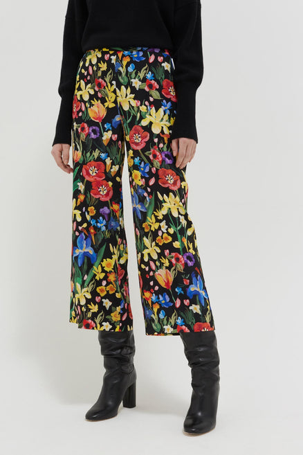 model shot of black-charleston-floral-print-silk-trousers Cut for a cropped, wide-leg fit From Chinti & Parker