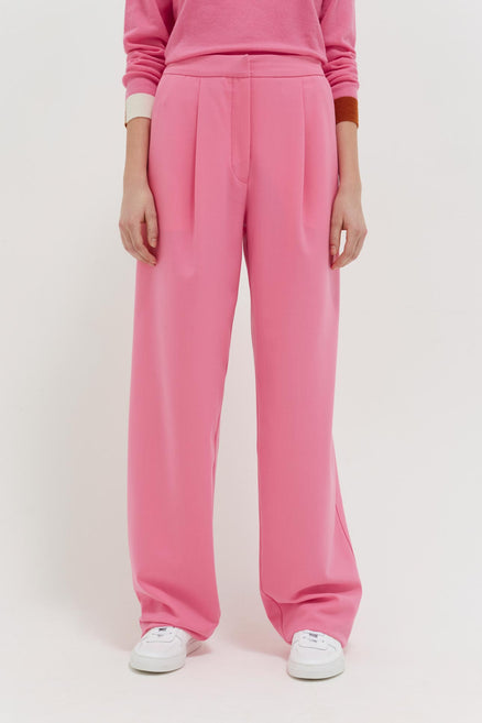 model shot of pink-pop-wool-twill-trousers straight-leg with a single front pleat and clean waistband From Chinti & Parker