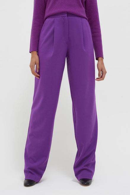 model shot of purple-pop-wool-twill-trousers straight-leg with single front pleat and clean waistband From Chinti & Parker
