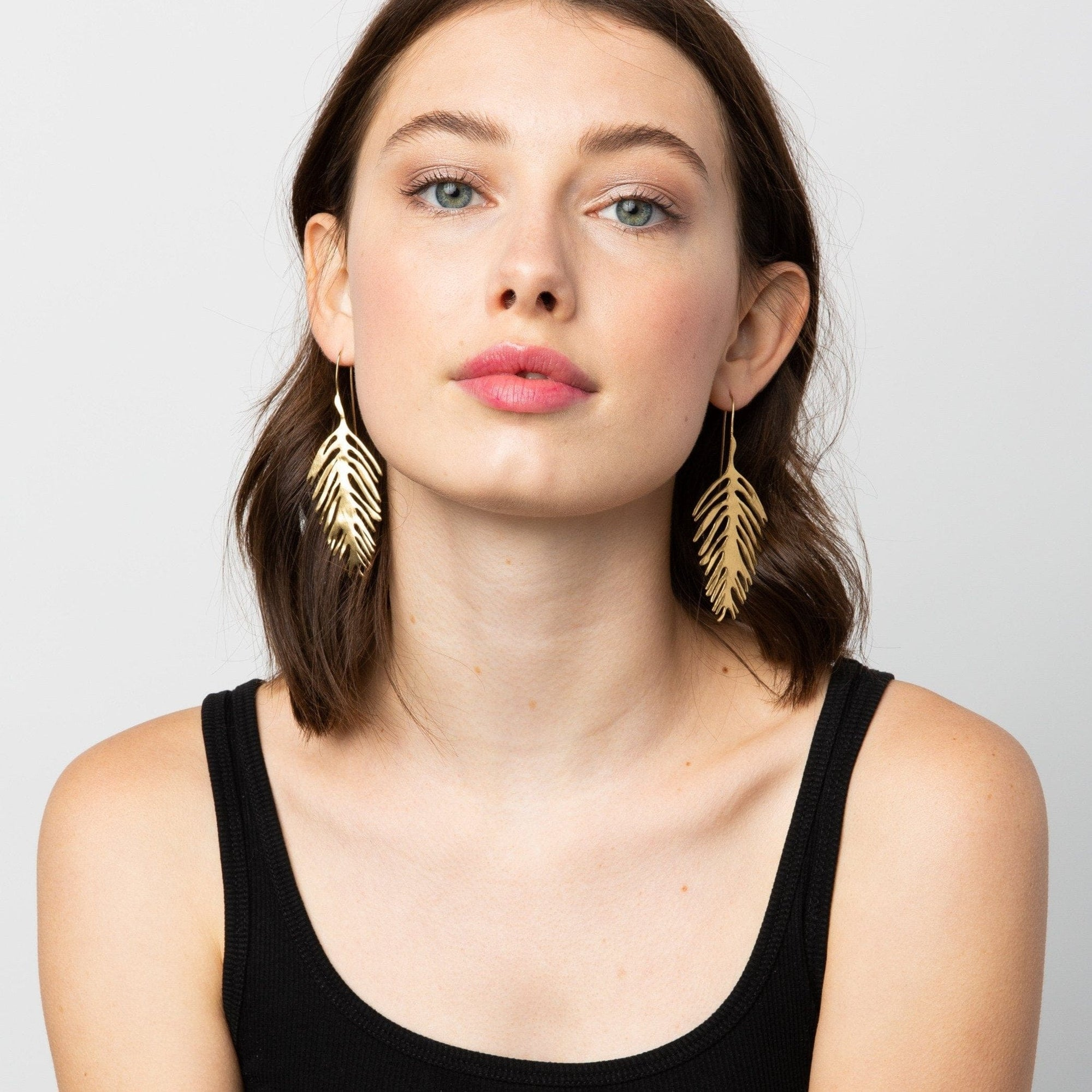brass palm leaf drop earrings