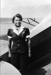 Willa Brown in front of a single engine plane