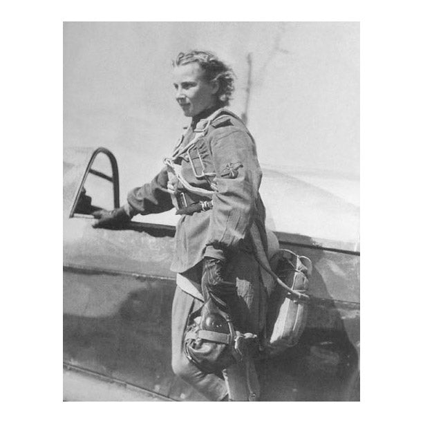 Lydia Litvyak standing next to her plane before a mission.