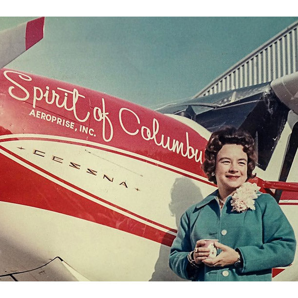 Jerrie Mock standing next to her Cessna 180, the Spirit of Columbus.