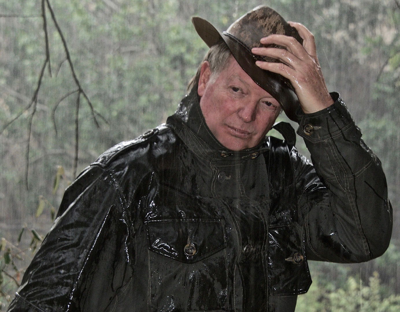 Don Young field testing our Weather Field Jacket in a downpour.