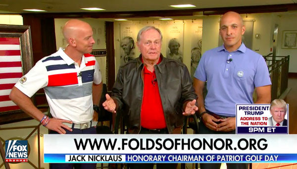 "Maj. Dan Rooney alongside PGA President Peter Bevacqua presented Golf Legend and 18 time champion, Jack ""The Golden Bear"" Nicklaus with a first edition hand painted Folds of Honor/Cockpit USA ""Freedom isn't Free"" A-2 leather flight jacket."