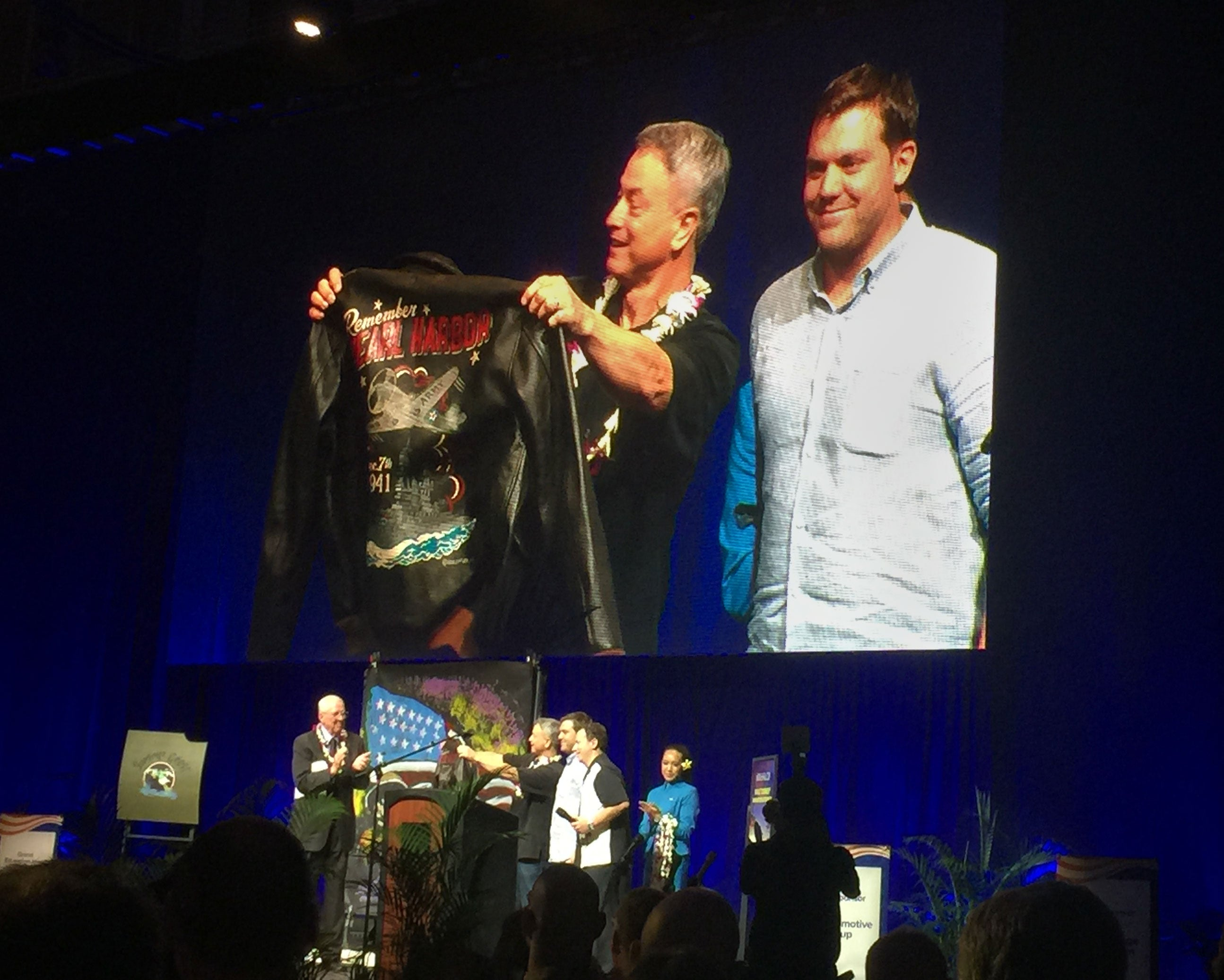 Mike Kennedy, a partner at Cockpit USA, presents Gary Sinise with one of our limited edition hand painted Remember Pearl Harbor A-2s.