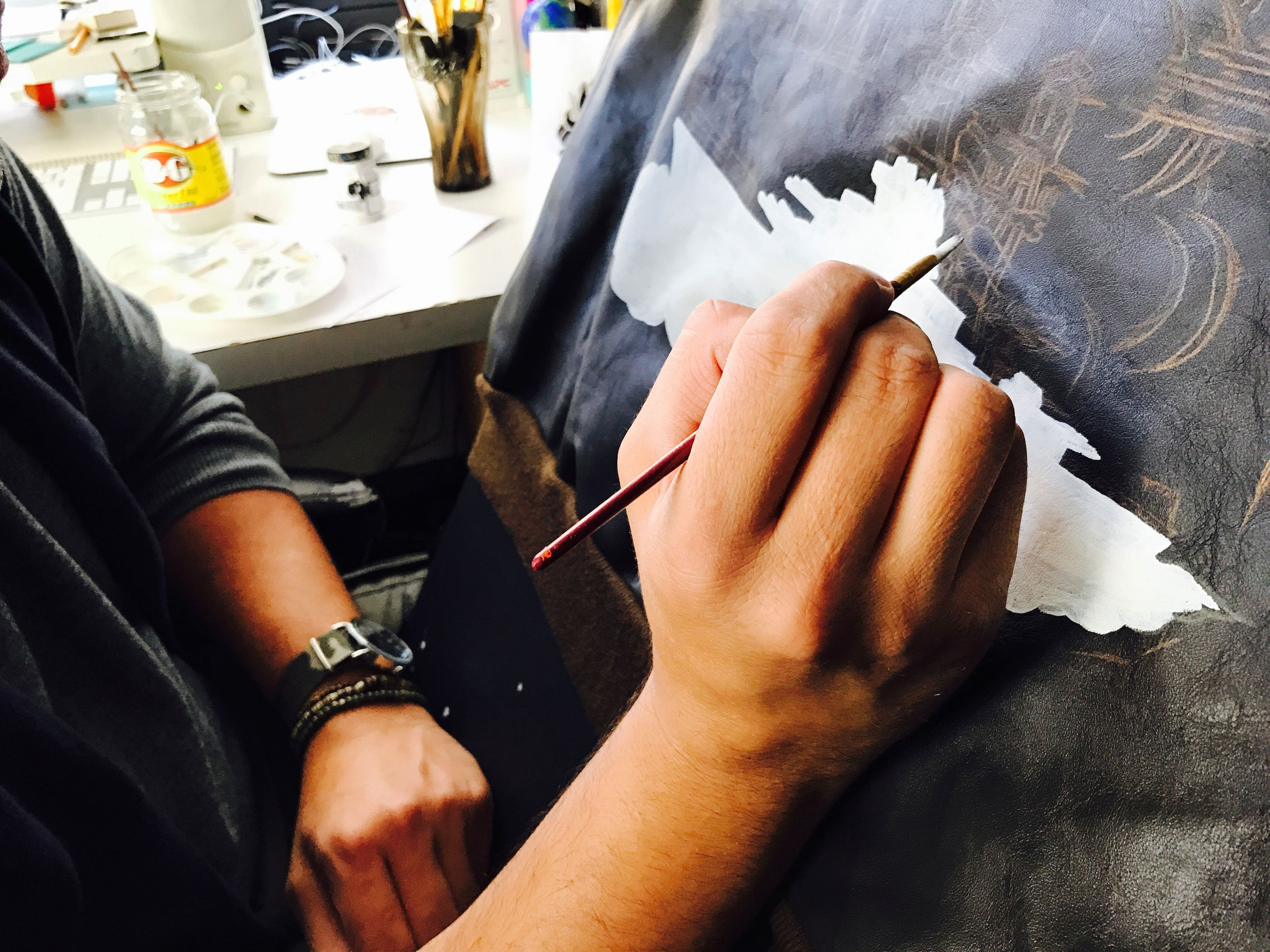Hand painting the back of our horsehide A-2.