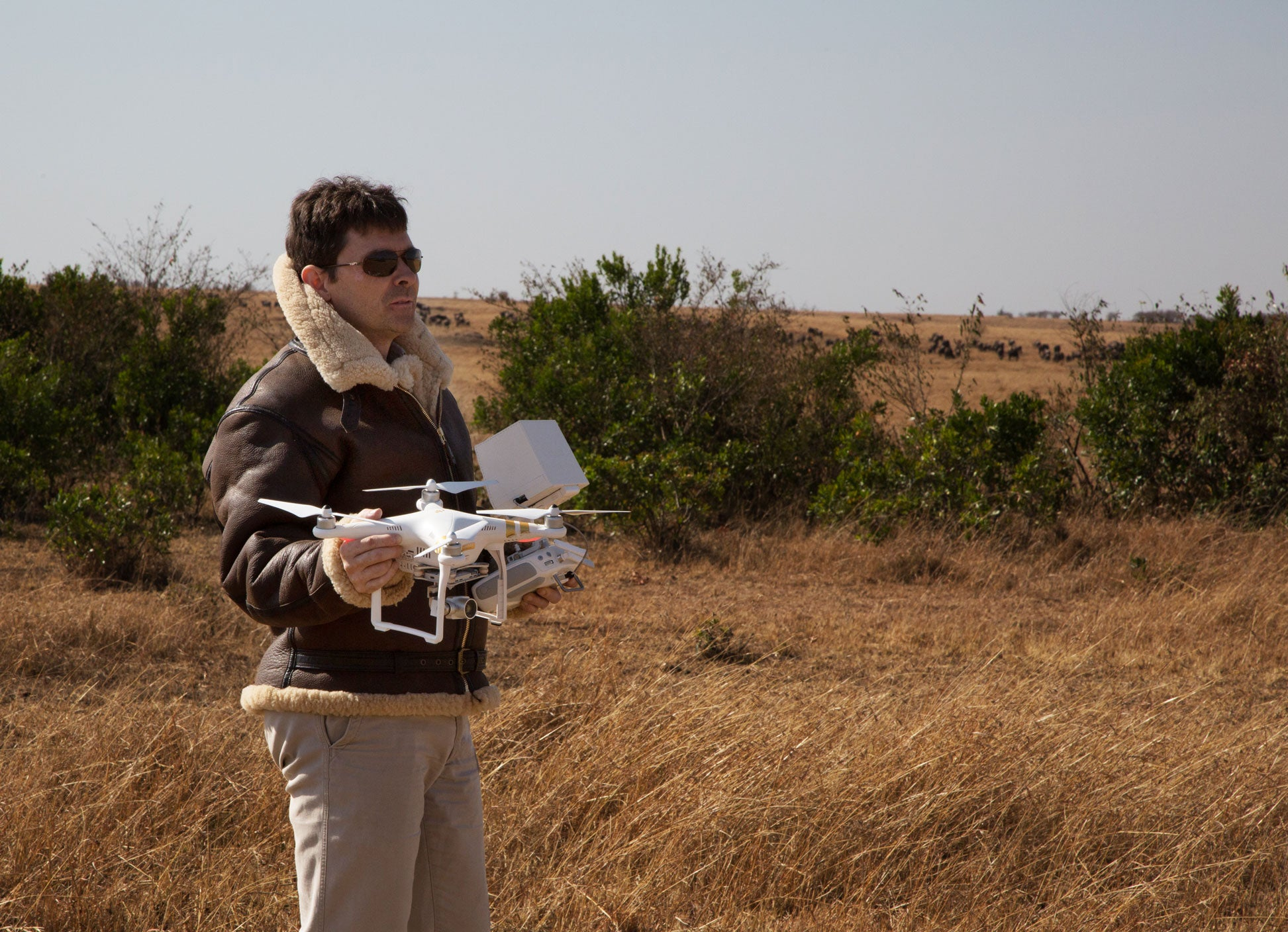 Matt Landis with his drone preparing to film the African wilderness.