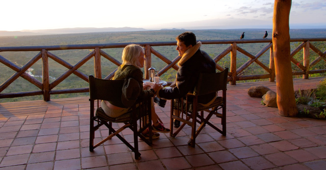 Matt Landis and his wife, Jen watching the sunset while on safari with Don Young.