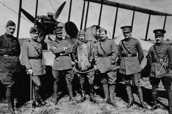 Montrose-Royal-Flying-Corps-officers-and-an-airmen-background-from-No-2-Squadron-pose-in-front-of-a-BE-2-biplane WWI