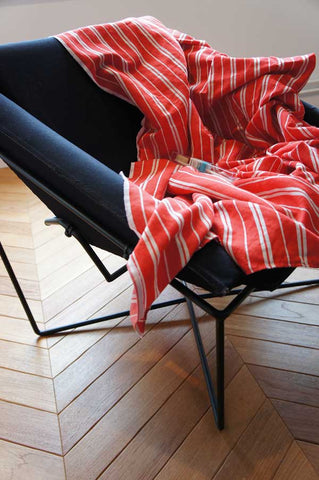 Our linen beach towel laid elegantly for a photo shoot of a toothbrush