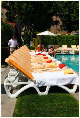 daan and ico linen towels laid elegantly out on beach chairs by pool/></a> </p>