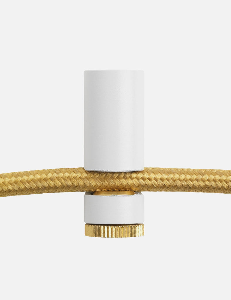 white ceiling hook with brass screw with chord close up
