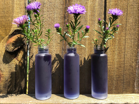 3 mist bottles with flowers