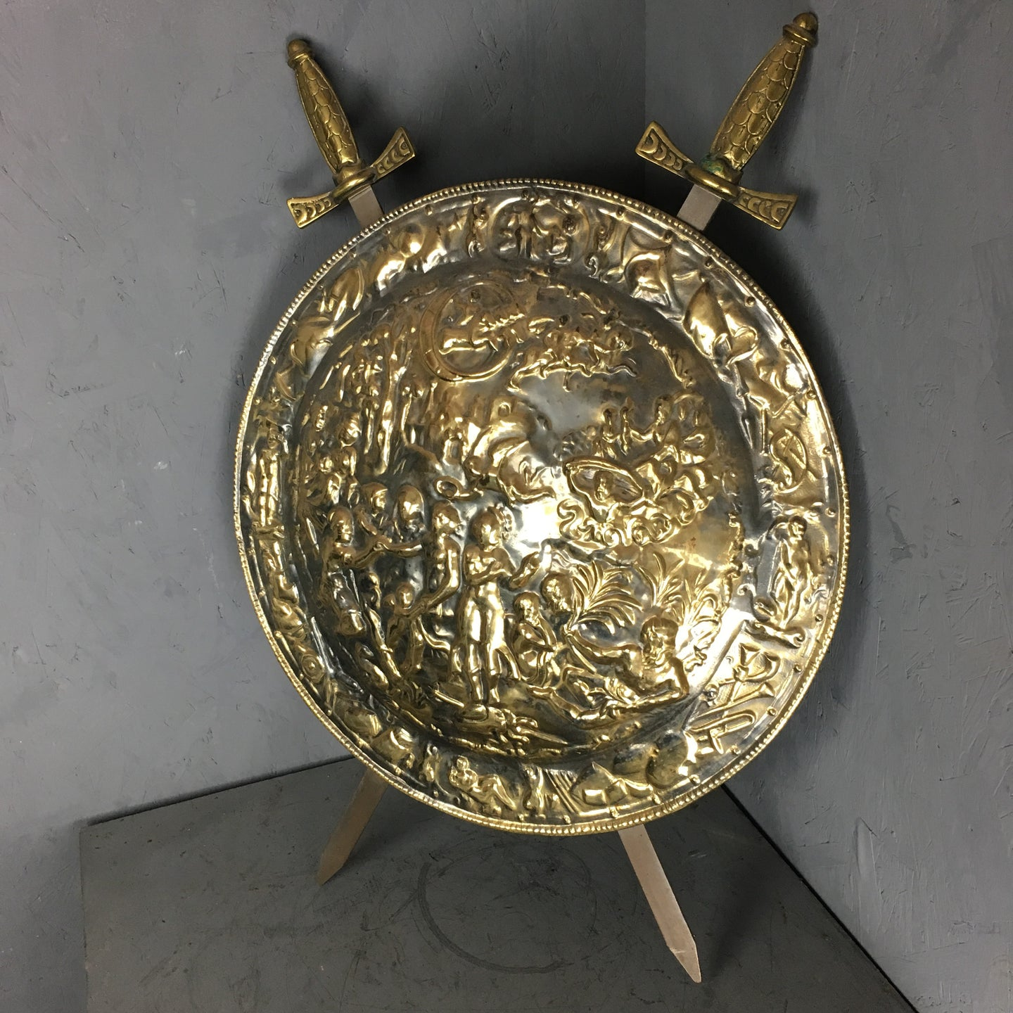 Decorative Repouso brass sheild with crosses swords