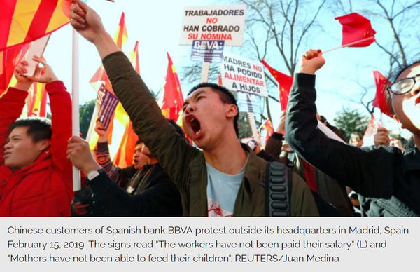 Chinese customers of Spanish bank BBVA protest outside its headquarters in Madrid, Spain