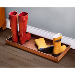 Steel Boot Tray with Flowers Design featuring 2 pairs of boots in an entryway or hall