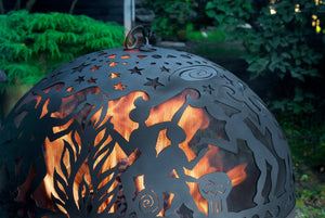 Full Moon Party FireDome with lit fire in a garden or backyard