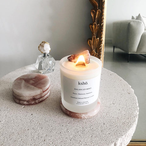 crystal infused candles on marble coaster