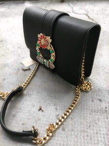 Sac a main noir fermoir strass