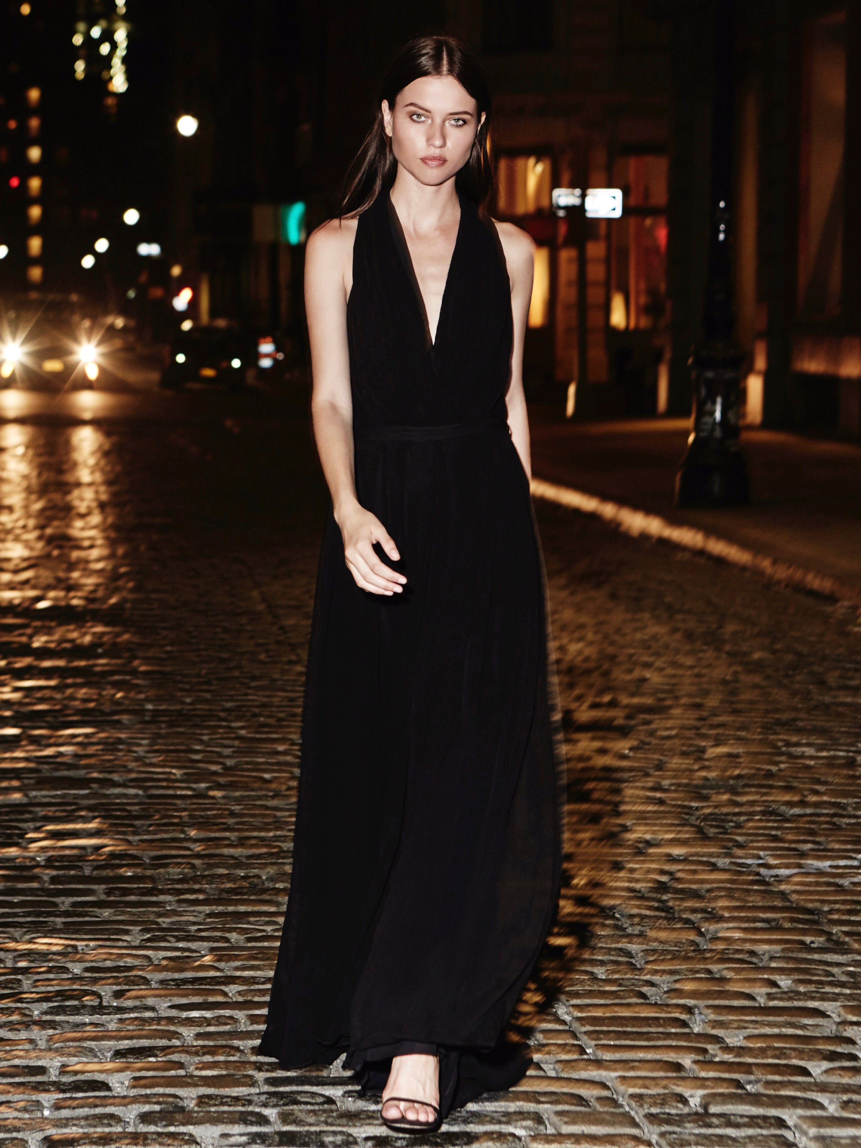 Seraphine wearing gown in black