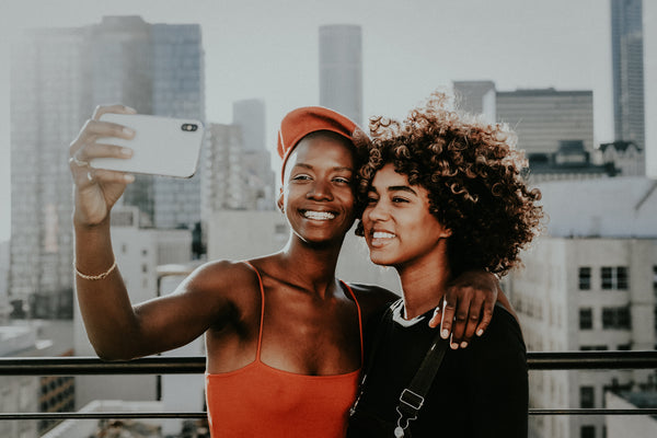 Two African american women taking selfie