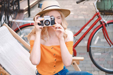 girl taking photo with old camera