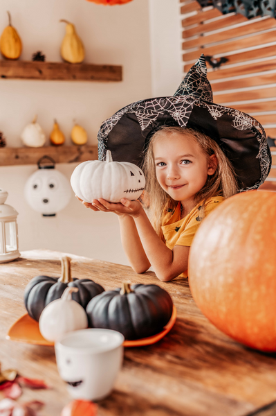 little girl with white pumpkin
