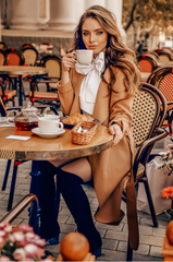 woman drinking coffee during autumn